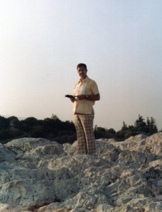 Charlie Jones reading his Bible in the Holy Land.